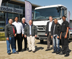 The team to make SA truckers proud – from left: Fast n Fresh driver, Basil Bailey; Fleetboard regional sales manager, Rowlands Peters; driver trainer Dennis Jolliffe; operations director Imperial Logistics Refrigeration Services, Attie Lubbe; MBSA Fleeboard manager, Pascal Weiss; Fast n Fresh driver, Pieter Adriaanse; and Fleetboard South Africa technical specialist Naveen Sook.