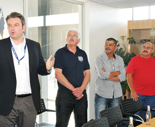 """""""No pressure…"""" Fleetboard manager Weiss addresses the attendees as trainer Jolliffe and drivers Adriaanse and Bailey look on confidently."""