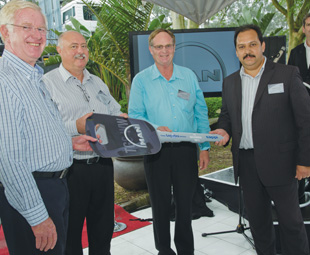 Pictured (from left) are: Brian Hunt (managing director of Timber Logistics), Eric Aspeling (distribution logistics manager: Sappi Forests), Robin Pretorius (transport development manager: Sappi Forests), and Bruce Dickson (deputy CEO: MAN Truck & Bus SA). In the background is Mark Gavin (national sales support manager at MAN Truck & Bus SA).