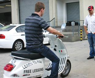 FOCUS's Gavin Myers samples Vespa's rider academy with Vespa rider trainer Torsten Neuendorf.