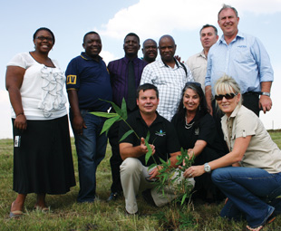 The partners kick off the project with a ceremonial planting of the bamboo shoots.
