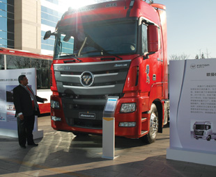 Ismail Asmal, CEO of Foton Trucks SA, admiring the new Auman GTL – launched in China by Foton Beijing.