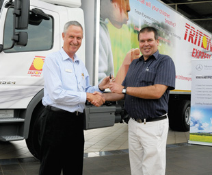 Johan van Jaarsveld, Mercedes-Benz Commercial Vehicles Centurion sales exceutive, congratulates Triton Express joint CEO, Eric Corbishley, on the purchase of the new vehicles.
