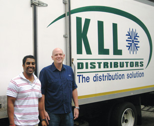 Praba Moonsamy of Ikhaya (left) and Gareth Curtis of KLL, with one of the vehicles that's been fitted with the Ikhaya temperature monitoring system.