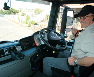 Blackie Swart, MAN driver training and assessment instructor, gladly shows Parker why trucking is such a passion of his.