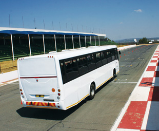 """Race tracks are not foreign ground to me, but the idea of your average commuter bus racing around one of the country's most well-known tracks (complete with full contingent of passengers) – well, that's new territory. Who would be brave enough to do that?  Mercedes-Benz, obviously. And why not? Being the world leader in bus chassis production has to count for something. The company was keen to show this off at its very first bus and coach track day held in mid-September at Kyalami Race Track in Midrand, Gauteng.  All Mercedes-Benz commuter bus chassis are imported from Brazil, and we're not talking about buses based on truck chassis. These are dedicated bus chassis – and driving around the track, it showed.  Guests were given the opportunity to sample four vehicles built on Mercedes-Benz chassis OF 1726 and OF 1730, fitted with 194 kW (260 hp) and 224 kW (300 hp) engines respectively. Two were fitted with Marcopolo bodies, one by MCV and one wearing a Busco Predator body. """"Climb in; we're going for a ride!"""" Not your everyday invitation, and not your everyday bus ride. With a member of the Mercedes-Benz Dynamic Driving team behind wheel, we were able to witness and experience the impressive road-holding, minimal lean angles, overall stability and impressive braking systems of the buses as they went through a slalom and around the rather technical track. Guests were also able to sample the buses' ease of maneuverability by competing in a parking exercise and were able to put their mechanicals to the test with a series of drag races. But it wasn't all fun and games – representatives from every area of Mercedes-Benz's bus and coach business were on hand to provide facts and figures.  """"After the World Cup, we expected the market to collapse,"""" says Mercedes-Benz South Africa vice president of Commercial Vehicles, Kobus van Zyl. """"But we then focused on customers requiring replacements with ready-built buses.""""  Sold through a dedicated bus dealer network, all aspects of the"""