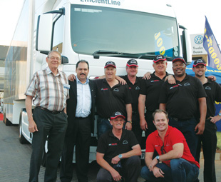 Taking a short break – (from left) Hellberg Transport Management founder Fritz Hellberg; Deputy CEO of MAN Truck & Bus SA Bruce Dickson; Tour drivers Dennis Flowers, Roland Marais, André Nel and Vusi Khoza; TGS product manager Dean Temlett; and (kneeling in front) Tour driver Blackie Swarts and Ignition TV presenter Marius Roberts.