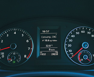 The CNG instrument cluster has two fuel gauges – gas on the left and petrol on the right (UK models of the van show speed in miles/hour).