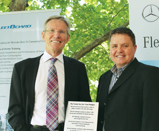 Joint chief executive of Cargo Carriers Murray Bolton (left) and Clinton Savage, divisional manager of Mercedes-Benz's Truck Division, taking the companies' relationship even further with the latter's Trucks You Can Trust Pledge.