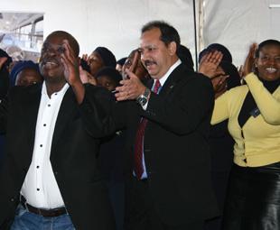GNT Director, E. Gwangwa, MAN CEO Bruce Dickson, and GNT CEO Busi Mhaga joining in with the St Engenas ZCC Church Choir.