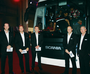 Above left: Some operators pre-ordered Scania's Touring coach, which makes its official South African debut at the Johannesburg International Motor Show this month. Above right: (from left) Ivan Stefanovic, sales and export director; Steen Gram, after sales director; Steve Wager, managing director of Scania South Africa; Matthew Lawrence, managing director of Scania Finance Southern Africa and Robbie Virgili, national sales manager bus and coach.