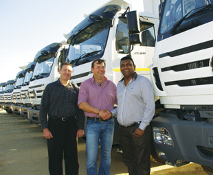 Kevin Naicker (right) takes delivery of his new fleet of vehicles from Powerstar's Gregory Erian (left) and Mark Beukes.