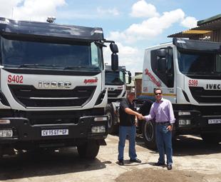 Lee Jones, MBS CEO, (left) takes delivery of his new Iveco Hi-Land Trakker fleet from Craig Jordan, Truck Centre MD.