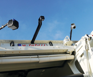 Cameras around the vehicle are part of the system that creates a bird's eye view of the vehicle's surroundings.