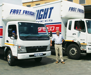 Des Alberts, operations director at Fast Freight, with two of his 53 Fuso vehicles.