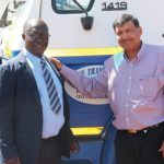 Andries Ndlehe and Sheldon Mayet with one of Leeu Transport's 19 trucks.