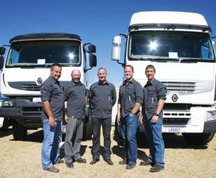 Showing off their diamonds at Nampo are, from left: Pieter Pieterse, sales executive; Reginald Knott, warranty manager; Herman Venter, acting national sales manager; Naas Burger, sales executive; Clifford Steele, sales engineer.
