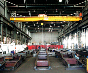 High-tensile steel is fabricated and welded to make chassis rails.