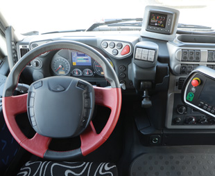 It's business as usual inside the Stralis, with an additional screen for the drive system.