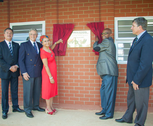 Revealing the plaque from left: Mike Hall-Jones, Key Pietermaritzburg MD; Colin Cowie, chairman of the GM Childlife Foundation; Gishma Johnson, GMSA corporate communications manager; Siyanda Secondary School principal, Selby Madlala; and Grace College principal, Vincent Luksich.