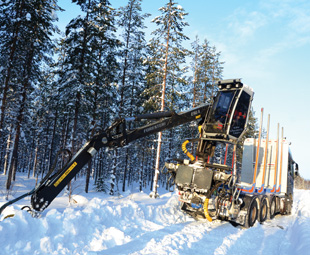 The truck-mounted crane was used in vain to help manoeuvre the truck tractor out of deep snow.