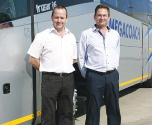 Paul Nel (left) and Leon Nelson stand proudly with the latest Mega Coach i6.