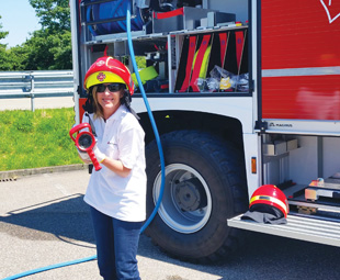 OCUS editor Charleen Clarke gets to grips with the art of firefighting, before being strapped in a cage for her ride up the fire ladder.