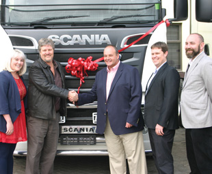 Scenes from the handover: pictured (from left) are Jolett and Andre van der Walt; Clifford Marchbank, managing director of Scania Truck Namibia; Jakkie van der Walt; and Jaco Zondagh, sales manager of Scania Namibia.