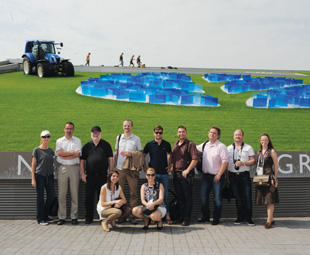 the media group in front of the highly innovative New Holland pavilion