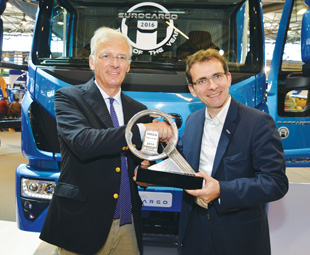 Pierre Lahutte, Iveco brand president (right), receives the coveted trophy from IToY chairman Gianenrico Griffini.