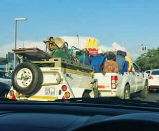 How many people can you fit on the back of a bakkie? Never too many, apparently ...