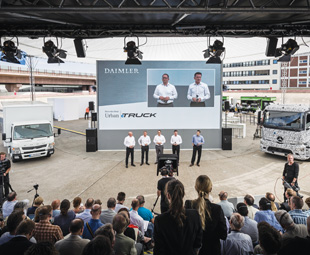 Daimler executives present the Urban eTruck (right) in tandem with the electric Fuso Canter, which has been tested by Stuttgart parcel firm Hermes.