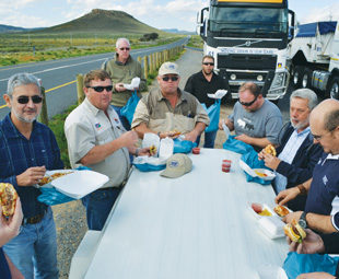 A trucker's lunch at the roadside provides a quick reprieve for the co-pilots.