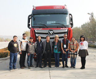 The Truck of the Year team of evaluators gathers in front of the Auman prior to the commencement of the first test. The Auman is produced by Beijing Foton Daimler Automotive, which sold 402 124 vehicles last year.