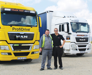 Gert Vorster (left) with Dean Temlett and the two MAN vehicles they piloted, the TGX 26.540 and TGS 26.480.