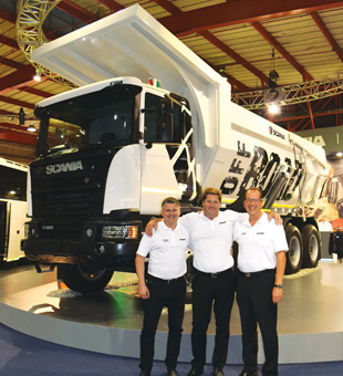 Pictured in front of a new 8x4 tipper, which offers 25-percent more payload than conventional tippers, are (from left) Taftman, Erasmus and Lehtiö.