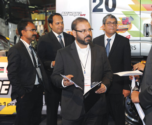 Rudarup Maitra, head of commercial vehicles, (centre) hosts a delegation at the Tata stand.