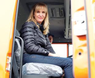 Charleen Clarke joins a KAMAZ test driver on the company's test track in Naberezhnye Chelny.